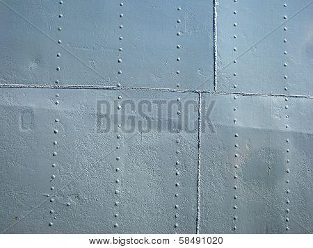 Detailed Gray Metal Historic Ship Wall With Seams And Rivets