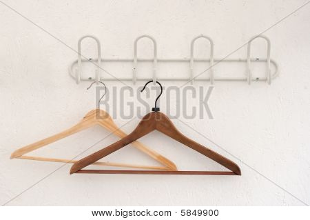 Pair Of Coathangers On The Wall