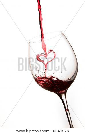 Pouring A Heart Of Red Wine In A Glass