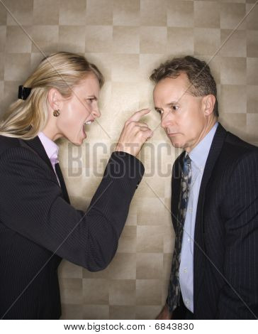 Businesswoman Reprimanding Businessman
