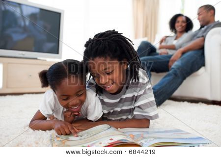 Concentrated Children Reading A Book