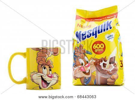 Ankara, Turkey - April 12, 2013: Nestle Nesquik powder and promotion mug isolated on white background.