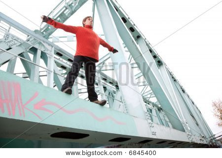 man guy is falling from the bridge stand