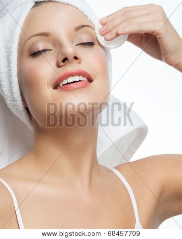 closeup portrait of attractive  caucasian smiling woman blond isolated on white studio shot lips toothy smile face hair head and shoulders towel mirrow cleaning cotton disc