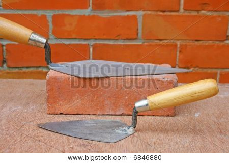 Bricklaying trowels.