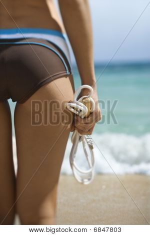Woman Holding Jump Rope At Beach