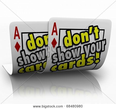 Don't Show Your Cards words on a pair of aces kept secret from your competition