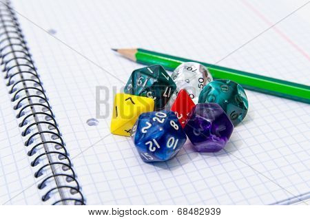 Set Of Open Exercise Book, Pencil And Dices