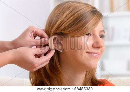 Putting on a deaf aid