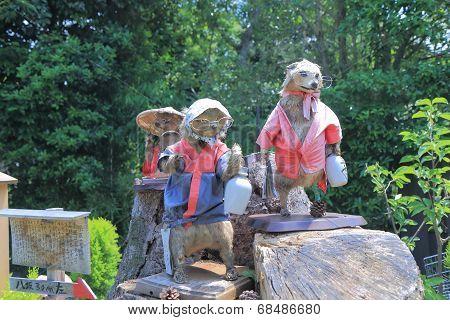 Racoon statures at Yasaka Shrine Kyoto Japan