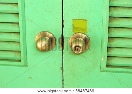 Doors  Knobs With Green Old Wood Background - Vintage Style.