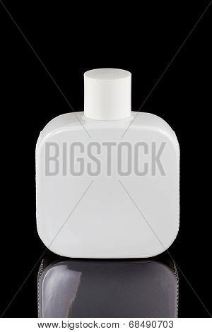 Four Perfume Spray Bottles  Isolated On Black Background
