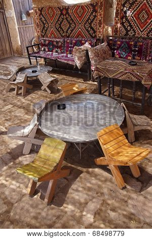 Tables And Chairs In Traditional Desert Oasis