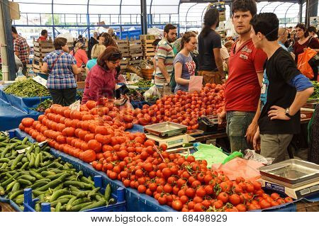 Shoppers Buy Tomatoes