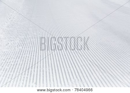 Prepared snowcat trail on a background of mountains. poster