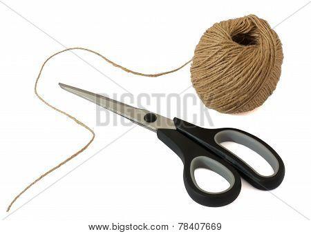 Scissors And Ball Of Woolen Thread