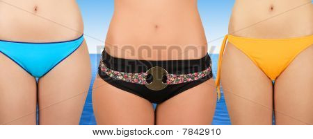 Three girls at bikini closeup on nature background poster