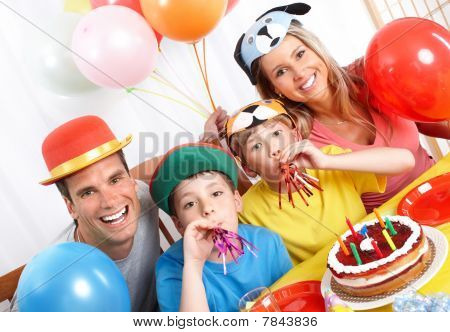 Happy family . Father mother and children celebrating birthday at home poster