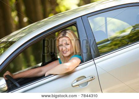 Beautiful Girl Enjoying Her New Car