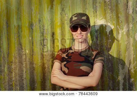 Smiling Young Woman Soldier in Camouflage Outfit
