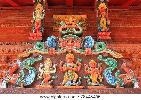 KATHMANDU, NEPAL - APRIL 2014 : Detailed of Hindu deities at the entrance panel of the Shree Kumari shrine in kathmandu, Nepal on 12 April 2014.