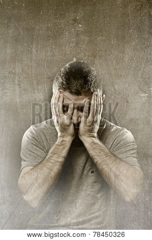 Man Suffering Depression, Headache ,migraine And Pain Covering Face With Hands