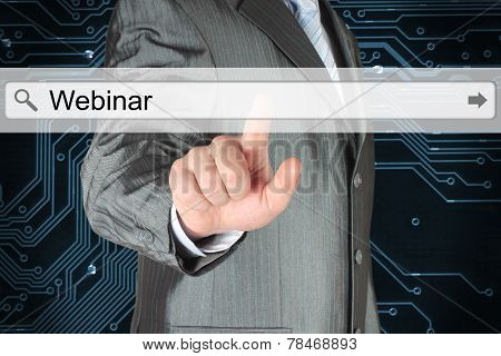 Businessman pushing virtual search bar with webinar word