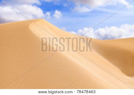 Sand dunes in Boavista desert with blue sky and clouds Cape Verde - Cap Vert poster