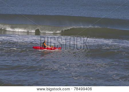 Breaking Waves And Kayaker