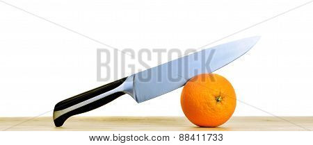 Orange With Knife