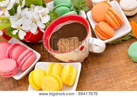Coffee and tasty treat (macaroons - macaron)