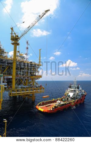 Crane operation on offshore construction platform.Cargo being loaded from a offshore platform