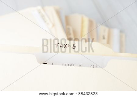 Yellow Paper Folder Labeled Taxes