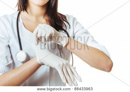 Doctor putting on white sterilized medical glove for making operation. woman wears latex surgical gl