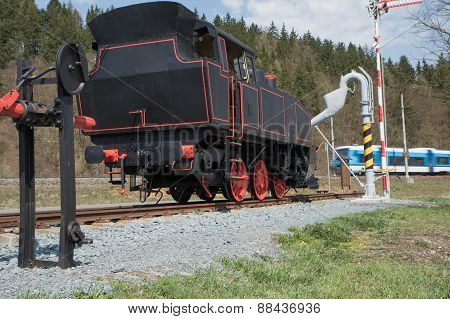 The Old Steam Locomotive And Modern Train