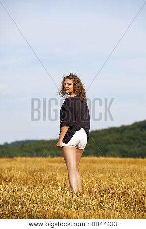 blond teenage girl walking away