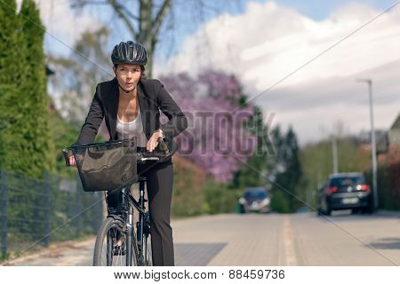 Businesswoman Commuting On A Cycle Going To Office