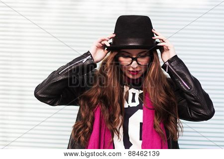 The Stylish Girl Puts On A Classical Hat