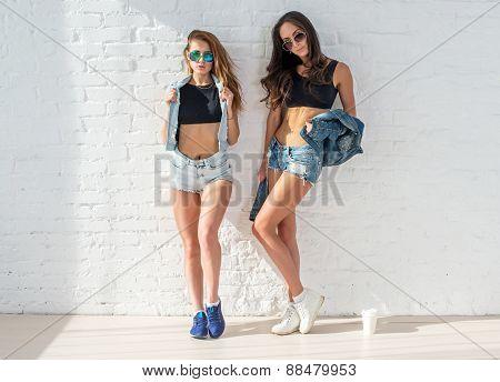 Fashion women friends wearing sunglasses in summer jeanswear street urban casual style having fun on