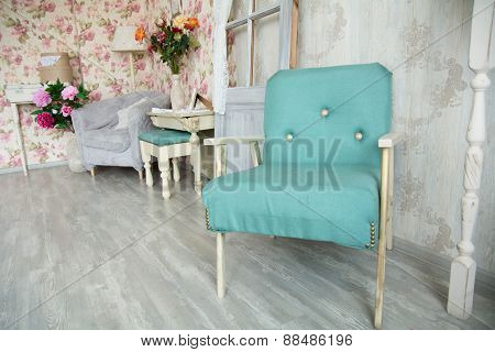 Interior Room With Green Armchair, Pillows, Door And Flowers.