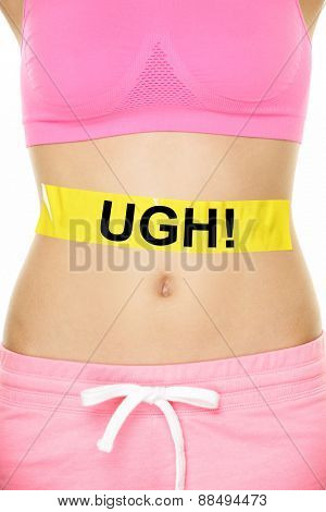 UGH my stomach hurts concept - girl with belly problems. Word written on yellow sign on female lower body to show abdomen pain or digestion issues, cramps or bloating, muscle ache.