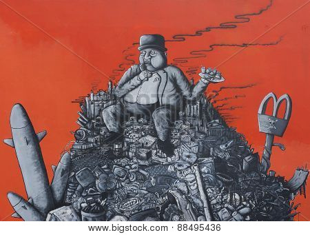 Graffiti: Fat Capitalist Sitting On A Heap Of Corporate Junk.