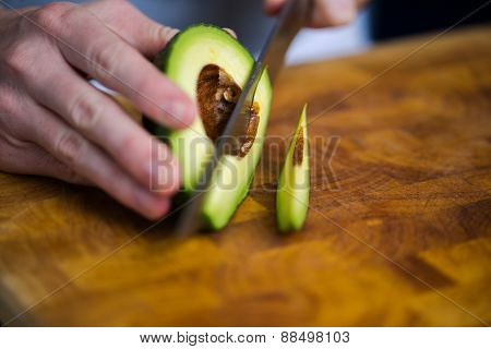 Ripe healthy avocado being sliced for breakfast