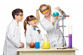 Teens and teacher of chemistry at chemistry lesson making experiments isolated on white background poster