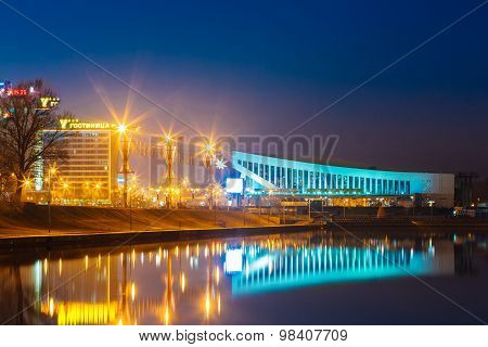 Palace Of Sports In Minsk At Night Scene Street. Downtown In Tow