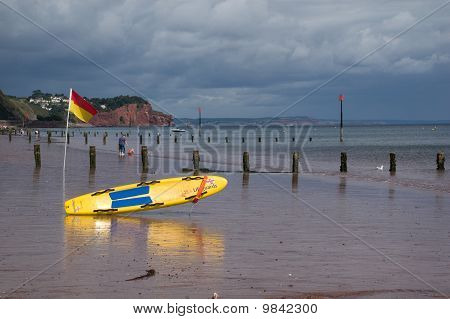 Lifeguards Surfe Board In Stormy Weather