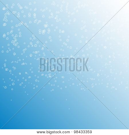 Bubbles in water on blue background