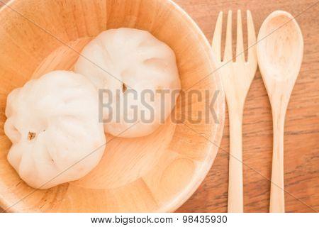 Steamed Dumpling Stuff On Wooden Bowl
