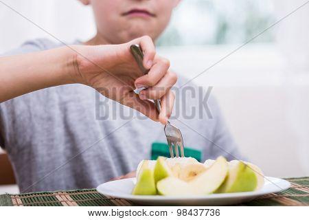 Displeased Boy Eating Apple