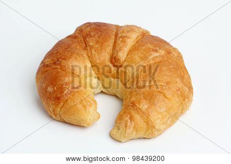 One Brown Glod Croissant